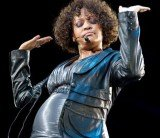 Globe magazine published a picture of Whitney Houston in which the singer seemed to have a bigger belly, suggesting she was pregnant, but nobody can confirm if the photo is real or not