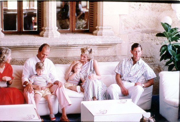 In one picture, King Juan Carlos of Spain sits with the small Prince William, while a radiant Princess Diana, a protective arm round toddler Prince Harry, leans in to share a pleasantry with the good-looking monarch