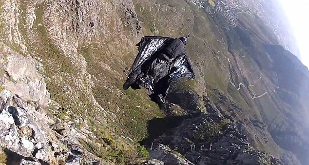 Jeb Corliss almost died after crashing into a cliff during a botched leap from Table Mountain in South Africa