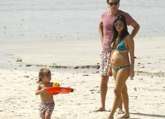 Kourtney Kardashian displayed her pregnancy shape while lapping up the sunshine in Mexico with boyfriend Scott Disick and her son Mason recently