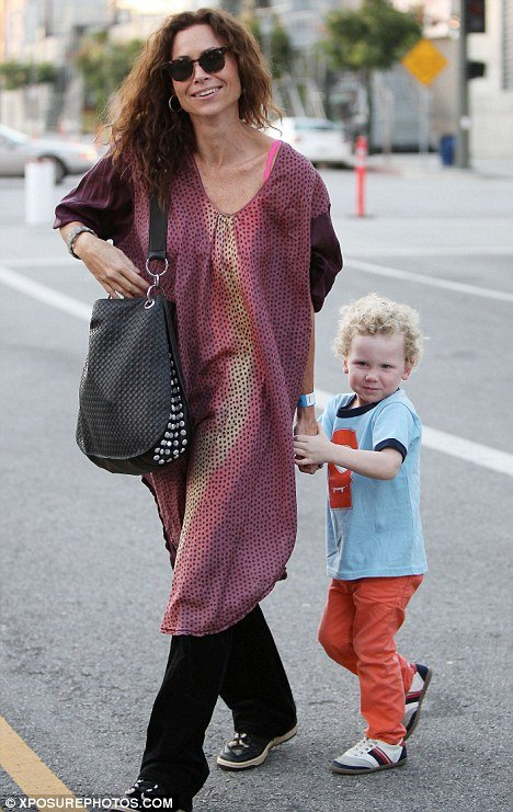 Minnie Driver revealed that three-year-old Henry's dad was a writer on her former television show The Riches