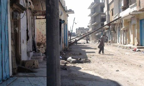 More than 200 people were killed by Syrian government forces which bombarded the city of Homs with tank shells and mortars, opposition groups say