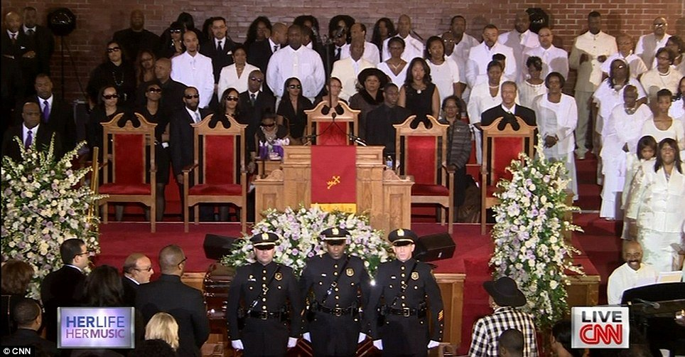 Mourners, officers and the choir gathered inside the New Hope Baptist Church at Whitney Houston's home-going service