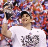 New York Giants quarterback Eli Manning poses with the Vince Lombardi Trophy after the Giants defeated the New England Patriots by a score of 21-17 in Super Bowl XLVI at Lucas Oil Stadium