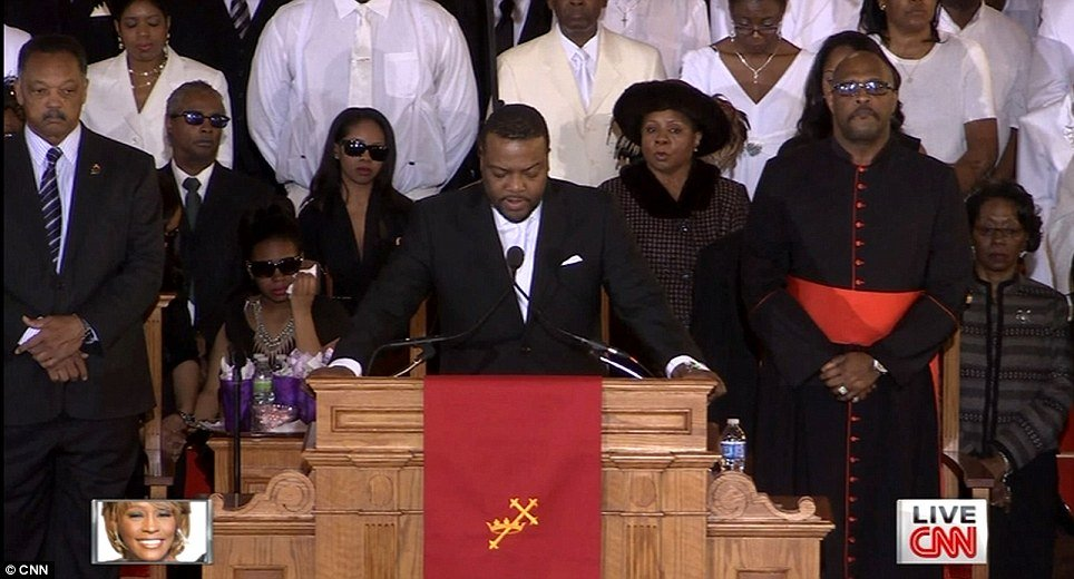 Pastor Joe Carter took to the alter to read some scripture and start the celebration of Whitney Houstons life photo