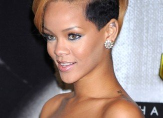 Rihanna is shortlisted to star as Whitney Houston in a movie biopic of the late singer