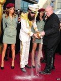 Sacha Baron Cohen stopped by security to pour the ashes on the red carpet at Oscars 2012
