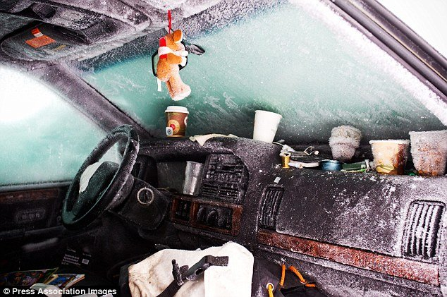 The images from inside Peter Skyllberg's car show the dashboard and seats covered in ice after temperatures plunged to -30C