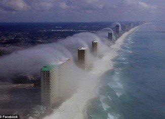 "The natural phenomenon ""waves of clouds"" occurred as a result of warm, moist air forming ""just right"" as it blew into the coastline, forming a low-lying fog that dissipates as the air cools with altitude"