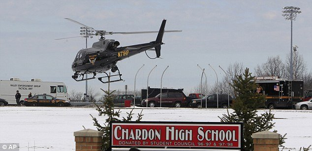 The students were shot by a gunman who opened fire in the cafeteria at Chardon High School, which was busy at breakfast time