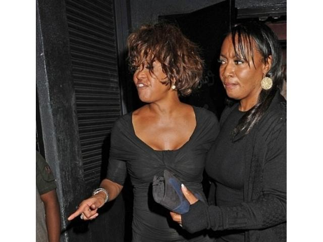 Tina Brown Whitney Houston' sister in law remembered the singer spent days locked in her bedroom amid piles of garbage smoking crack photo