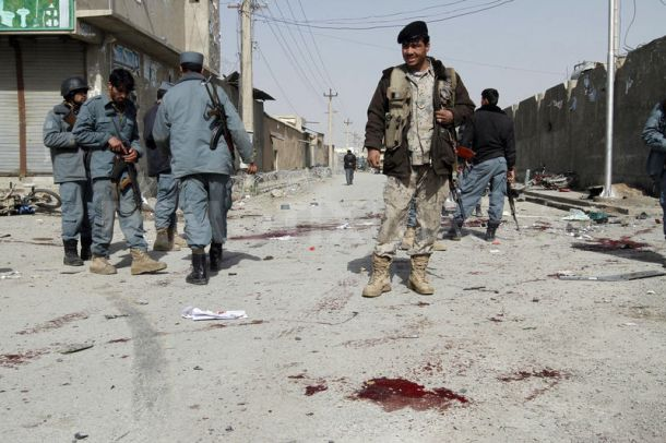 Two civilians and at least five police officers have died in a car bomb attack on police headquarters in the city of Kandahar, southern Afghanistan