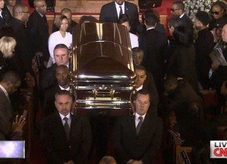 Whitney Houston's casket was carried out of the church while her unforgettable voice could be heard singing her greatest hit I Will Always Love You