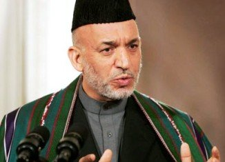 Afghan President Hamid Karzai accuses the US of not fully co-operating with a probe into the Kandahar massacre of 16 civilians by an American soldier