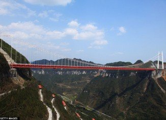 Aizhai Extra Large Suspension Bridge is now the world's highest and longest tunnel-to-tunnel bridge