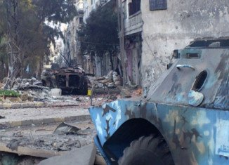 At least 47 people have been killed in an attack by pro-government militia in the embattled Syrian city of Homs