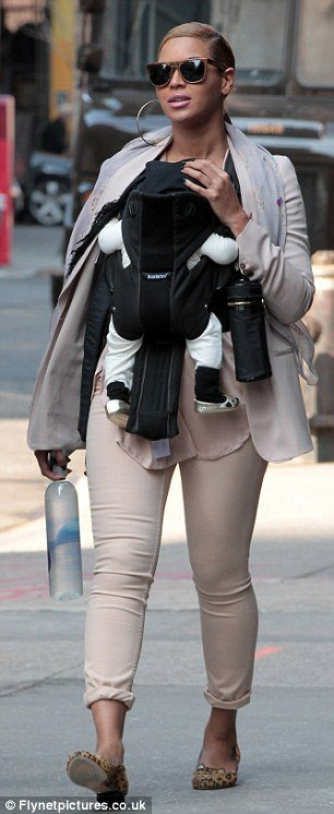 Blue Ivy was wearing a pair of golden booties as her mother Beyoncé walked her around Manhattan yesterday