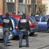 French police have arrested 19 suspected Islamists and seized weapons in a series of dawn raids