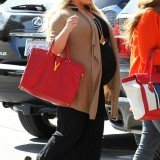 Heavily pregnant Jessica Simpson is refusing to put her feet up less than a few weeks away from her due date