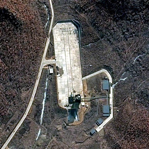 Japan announces that will shoot down a North Korean rocket if necessary, as new satellite images appeared to show preparations for the April launch