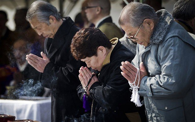 Japan marks one year commemoration of the devastating earthquake and tsunami, which struck the north-eastern coast, leaving 20,000 dead or missing