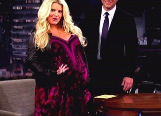 Jessica Simpson has put her extremely blooming figure down to the fact that she has a lot of amniotic fluid