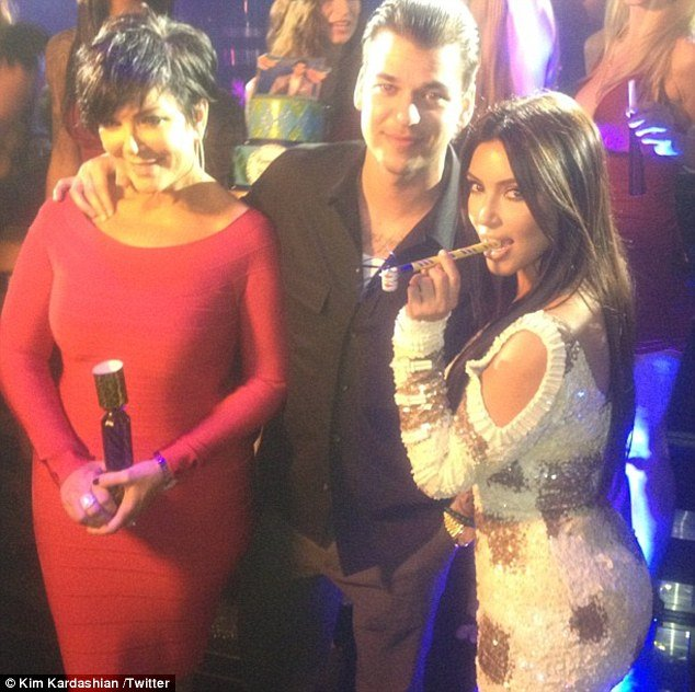 Kris Jenner, her son Rob Kardashian and daughter Kim in the 1 Oak Club at the Mirage Hotel in Las Vegas celebrating his 25th birthday