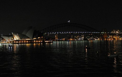 The Sydney Opera House and the Sydney Harbour Bridge plunged into darkness today to raise the profile of climate change
