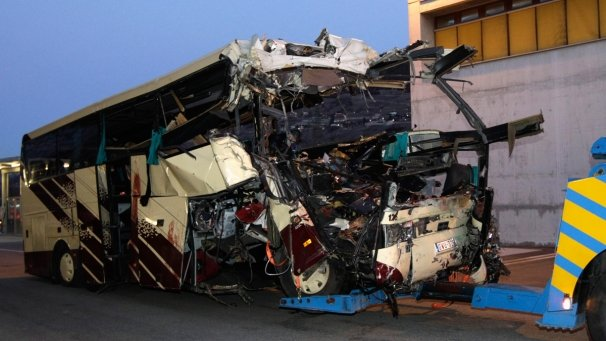 The coach, carrying 52 people back to Belgium, hit a wall in the tunnel head-on