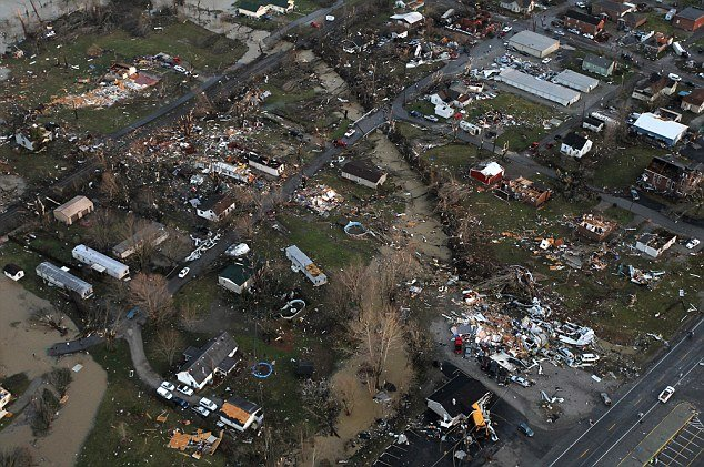 "Tornadoes have destroyed towns in Southern Indiana, including Henryville, pictured, and neighboring Marysville, which is ""completely gone"""