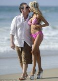Wearing her iconic sky-high heels, Courtney Stodden hit the beach with her husband Doug Hutchison over the weekend