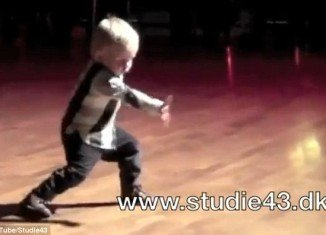 William Stokkebroe, 2, wins over the crowd by gyrating his hips, clapping, tapping his feet and attempting to sing along to Jailhouse Rock