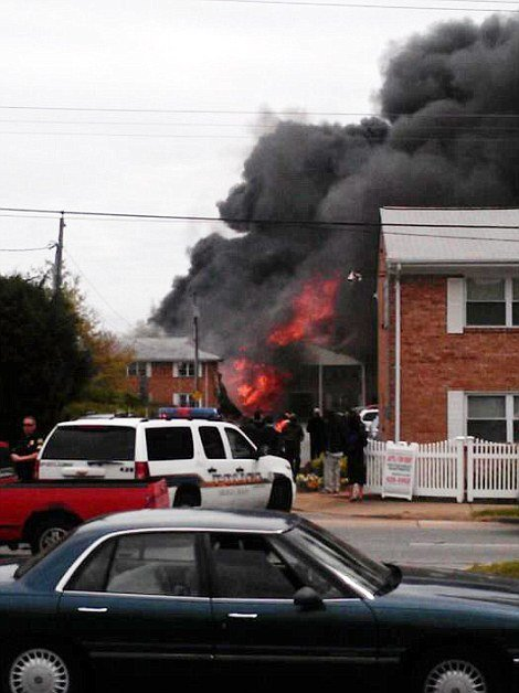 A US Navy F-18 fighter jet has crashed into an apartment complex in the suburbs of Virginia Beach