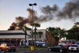 A witness reported that the twin-engine plane appeared to have crashed into the roof of a Publix chain supermarket