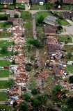 An unprecedented cluster of tornadoes ripped through major towns and cities in Texas yesterday