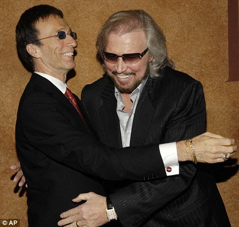 "Barry Gibb sang to Robin by his bedside and a source close to the family said this prompted ""flickers of life"" photo"