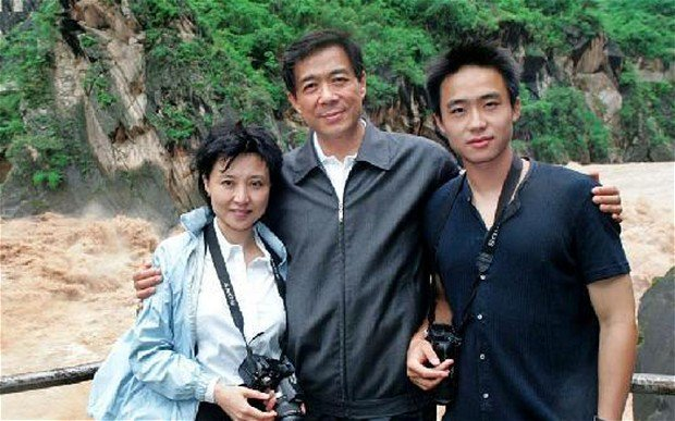 Bo Guaga pictured with his father Bo Xilai and his mother Gu Kailai photo