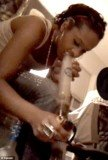 Bobbi Kristina Brown is seen smoking what appears to be marijuana out of a bong in an image taken from a video filmed in March 2011