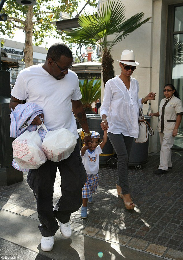 Bobby Brown showed off his gentler side as he walked hand in hand with his son Cassius and fiancée Alicia Etheridge at The Grove shopping centre in Los Angeles