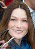 Carla Bruni looked almost unrecognizable yesterday as she voted in the French presidential elections