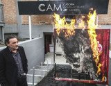 Casoria Contemporary Art Museum director Antonio Manfredi sets fire to a Severine Bourguignon painting