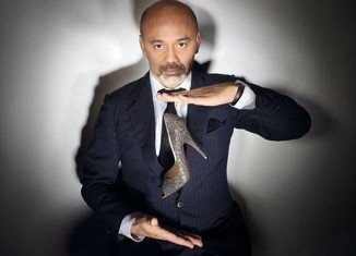 Christian Louboutin says he feels no sympathy for those who suffer while wearing his designs, describing the relationship between a woman and her heels as a quasi-masochistic experience