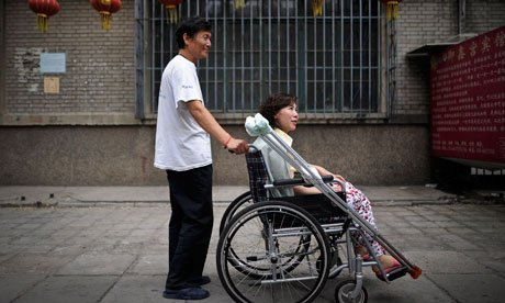 Disabled Chinese land rights lawyer Ni Yulan and her husband Dong Jiqin have been jailed a year after they were detained photo