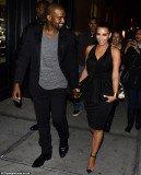 Kim Kardashian and Kanye West arrived together holding hands to the opening of Kourtney's boyfriend Scott Disick's restaurant