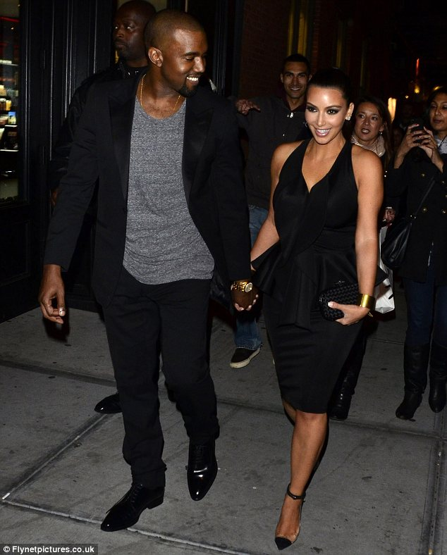 Kim Kardashian and Kanye West arrived together holding hands to the opening of Kourtney's boyfriend Scott Disick's restaurant
