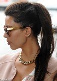 Kim Kardashian wearing Kanye West's initials in her ear