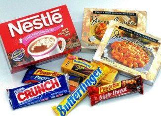 "Nestle, the world's biggest food group has reported rising sales but says it is having a ""challenging year"""