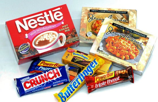 """Nestle, the world's biggest food group has reported rising sales but says it is having a """"challenging year"""""""