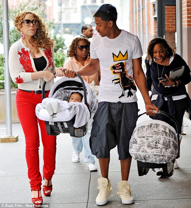 Nick Cannon was seen dressed in an outfit much younger than his years as he stepped out with Mariah Carey and their children photo