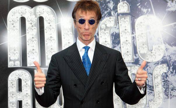 Robin Gibb has woken from a coma after more than a week and begun to show signs of recovery